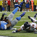 Detroit Lions wide receiver Calvin Johnson (81), defended by Chicago Bears cornerback Kyle Fuller (23), falls into the end zone for a 25-yard reception for a touchdown during the first half of an NFL football game in Detroit, Thursday, Nov. 27, 2014 The A
