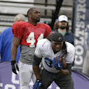 Indianapolis Colts running back Trent Richardson (34) and Ahmad Bradshaw (44) run a drill during NFL football training camp Tuesday, Aug. 12, 2014, in Anderson, Ind The Associated Press