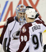 Colorado Avalanche's goalie Semyon Varlamov, of Russia, is congratulated by teammate Ryan O'Reilly (90) after their victory over the St. Louis Blues in an NHL hockey game, Saturday, April 5, 2014, in St. Louis. The Avalanche won 4-0. (AP Photo/Bill Boyce)