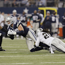 Dallas Cowboys tight end Jason Witten (82) is taken down by Oakland Raiders free safety Usama Young (26) and Charles Woodson (24) during the second half of an NFL football game, Thursday, Nov. 28, 2013, in Arlington, Texas The Associated Press