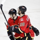 Calgary Flames' TJ Galiardi, right, celebrates his goal against the Los Angeles Kings with Jiri Hudler, from the Czech Republic, during first period NHL action in Calgary, Alta., Wednesday, April 9, 2014 The Associated Press