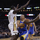 Golden State Warriors point guard Stephen Curry (30) drives to the basket against New Orleans Pelicans point guard Jrue Holiday (11) in the first half of an NBA basketball game in New Orleans, Tuesday, Nov. 26, 2013. (AP Photo/Gerald Herbert)
