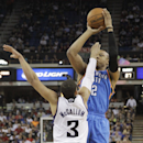 Oklahoma City Thunder forward Caron Butler shoots over Sacramento Kings guard Ray McCallum during the fourth quarter of an NBA basketball game, Tuesday, April 8, 2014, in Sacramento, Calif. The Thunder won 107-92 The Associated Press