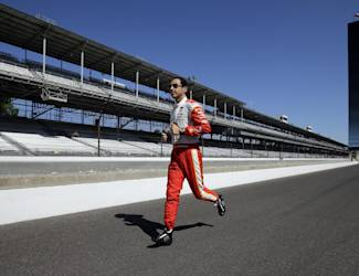 Helio Castroneves, of Brazil, runs down pit lane before the start of the final practice session for the Indianapolis 500 auto race at Indianapolis Motor Speedway in Indianapolis, Friday, May 22, 2015. (AP Photo/Darron Cummings)