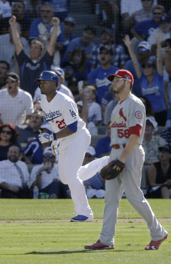 Los Angeles Dodgers' Carl Crawford runs after hitting a home run off St. Louis Cardinals starting pitcher Joe Kelly during the fifth inning of Game 5 of the National League baseball championship series, Wednesday, Oct. 16, 2013, in Los Angeles