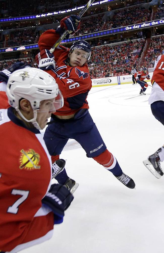 Florida Panthers defenseman Dmitry Kulikov (7), from Russia, collides with Washington Capitals center Michael Latta (46) in the third period of an NHL hockey game, Saturday, Nov. 2, 2013, in Washington. The Capitals won 3-2 in a shootout