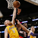 Portland Trail Blazers forward LaMarcus Aldridge loses the ball as he goes to the basket, while Los Angeles Lakers' Chris Kamabn, left, and Pau Gasol, right, defend during the first half of an NBA basketball game in Los Angeles, Tuesday, April 1, 2014 The
