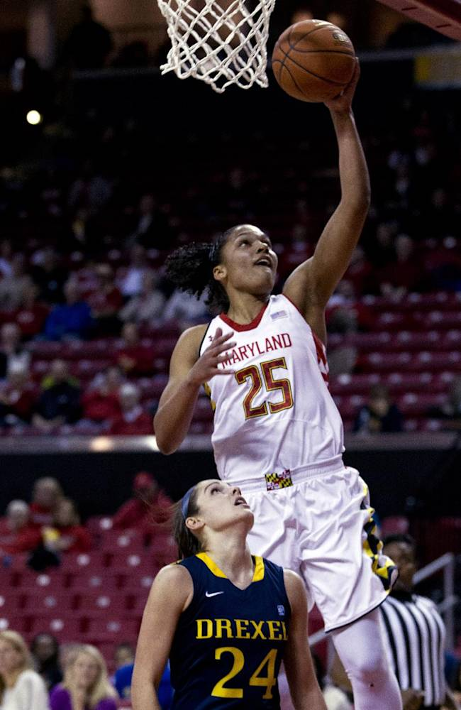 Maryland's Alyssa Thomas (25) goes for the basket as Drexel Rachel Pearson (24) looks on during the first half of an NCAA college basketball game at the Comcast Center in College Park, Md., Monday, Nov. 25, 2013