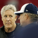 Seattle Seahawks head coach Pete Carroll, left, talks with quarterbacks coach Carl Smith during a team practice for NFL Super Bowl XLIX football game, Friday, Jan. 30, 2015, in Tempe, Ariz. The Seahawks play the New England Patriots in Super Bowl XLIX on