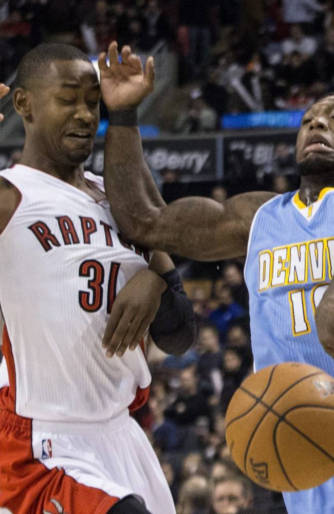 Toronto Raptors' Terrence Ross, left, fouls Denver Nuggets' Nate Robinson during the first half of an NBA basketball game on Sunday, Dec. 1, 2013, in Toronto