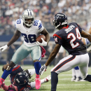 Dallas Cowboys wide receiver Dez Bryant (88) escapes from Houston Texans defensive back Danieal Manning (38) and evades Johnathan Joseph (24) during the second half of an NFL football game, Sunday, Oct. 5, 2014 in Arlington, Texas The Associated Press
