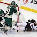 Chicago Blackhawks' Bryan Bickell, right, falls to the ice after his shot was stopped by Minnesota Wild goalie Devan Dubnyk, left, in the third period of an NHL hockey game, Tuesday, Feb. 3, 2015, in St. Paul, Minn. The Wild won 3-0 The Associated Press