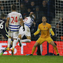 QPR's Bobby Zamora, center, scores their second goal during the English Premier League soccer match between Queens Park Rangers and Manchester City at Loftus Road stadium in London, Saturday, Nov. 8, 2014