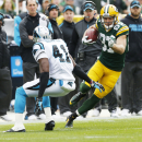 Green Bay Packers' Jordy Nelson (87) gets past Carolina Panthers' Roman Harper (41) for a touchdown catch during the first half of an NFL football game Sunday, Oct. 19, 2014, in Green Bay, Wis The Associated Press
