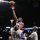 New York Knicks' Amare Stoudemire shoots over Brooklyn Nets' Paul Pierce (34) and Kevin Garnett during the second half of an NBA basketball game Tuesday, April 15, 2014, in New York. The Knics won 109-98 The Associated Press