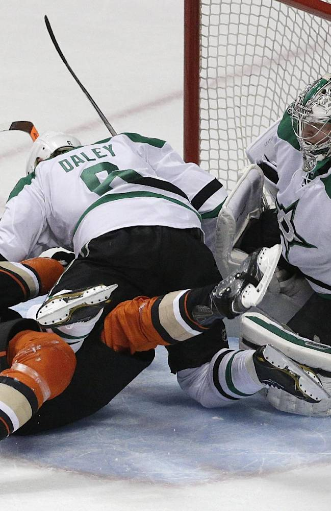 Dallas Stars' Trevor Daley (6) fights with Anaheim Ducks' Corey Perry (10) in front of Stars goalie Kari Lehtonen, of Finland, during the first period in Game 2 of the first-round NHL hockey Stanley Cup playoff series on Friday, April 18, 2014, in Anaheim, Calif