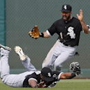 Chicago White Sox left fielder Dayan Viciedo dives to catch a Cleveland Indians' Carlos Santana fly ball as Adam Eaton celebrates during an exhibition baseball game in Goodyear, Ariz., Tuesday, March 4, 2014 The Associated Press
