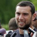 Indianapolis Colts quarterback Andrew Luck talks with the media as the players arrived for the NFL team's football training camp in Anderson, Ind., Wednesday, July 23, 2014 The Associated Press