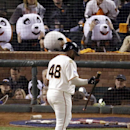 This Oct. 25, 2014, file photo shows San Francisco Giants' Pablo Sandoval walking past fans wearing panda heads after he strikes out during the third inning of Game 4 of baseball's World Series against the Kansas City Royals in San Francisco. With Sandova