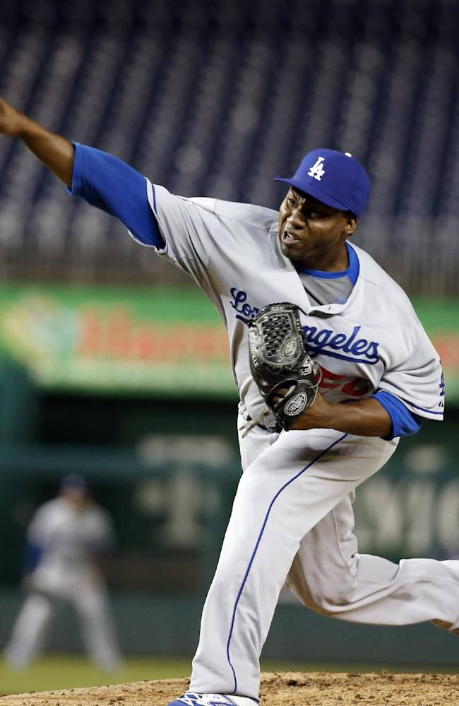 Los Angeles Dodgers relief pitcher Pedro Baez throws during the eight inning of a baseball game against the Washington Nationals at Nationals Park, Tuesday, May 6, 2014, in Washington. The Nationals won 4-0