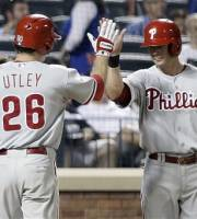 Philadelphia Phillies' Chase Utley, left, celebrates with teammate Michael Young, right after hitting a two-run home run during the fifth inning of a baseball game against the New York Mats, Friday, July 19, 2013, in New York. (AP Photo/Frank Franklin II)