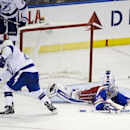 New York Rangers goalie Henrik Lundqvist (30), of Sweden, watches as Tampa Bay Lightning's Ryan Callahan (24) shoots the puck to score during the third period of an NHL hockey game Monday, Nov. 17, 2014, in New York. The Lightning won the game 5-1 The Ass