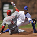 Chicago Cubs' Starlin Castro, right, tries to apply the tag on Cincinnati Reds' Billy Hamilton (8) who steals second base during the third inning of a baseball game in Chicago, Sunday, April 20, 2014. Cincinnati won 8-2 The Associated Press