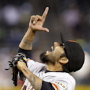 San Francisco Giants' Sergio Romo points to the sky as he celebrates the final out against the Arizona Diamondbacks in a baseball game, Wednesday, April 2, 2014, in Phoenix. The Giants defeated the Diamondbacks 2-0 The Associated Press
