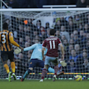 West Ham's Stewart Downing, right, scores his side's third goal during the English Premier League soccer match between West Ham and Hull City at Upton Park stadium in London, Sunday, Jan. 18, 2015
