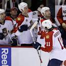 Florida Panthers center Jonathan Huberdeau (11) is congratulated by teammates after his go-ahead goal during the third period of an NHL hockey game against the Detroit Red Wings in Detroit, Saturday, Dec. 7, 2013. (AP Photo/Carlos Osorio)