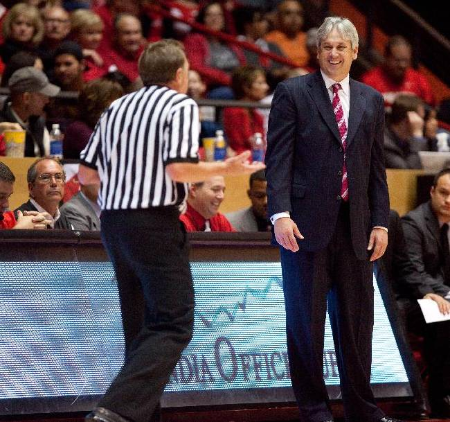 New Mexico head basketball coach Craig Neal, right, reacts to the official during his team's 109-93 victory over Charleston Southern in an NCAA college basketball game Sunday, Nov. 17, 2013 in Albuquerque, N.M