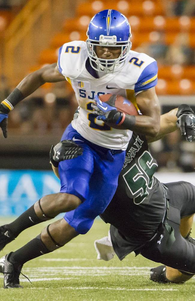 San Jose State wide receiver Tim Crawley (2) attempts to break away from Hawaii linebacker Brenden Daley (56) in the fourth quarter of an NCAA college football game Saturday, Oct. 5, 2013, in Honolulu. San Jose State defeated Hawaii 47-37