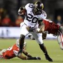 Minnesota's Donnell Kirkwood (20) rushes against the UNLV defense during an NCAA college football game, Thursday, Aug. 30, 2012, in Las Vegas. (AP Photo/David Becker)