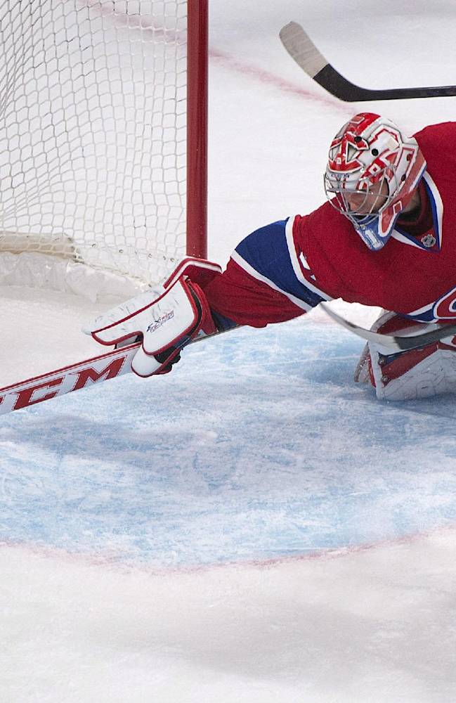 Montreal Canadiens goaltender Carey Price, left, makes a save against Carolina Hurricanes' Eric Staal during the second period of a preseason NHL hockey game in Montreal, Saturday, Sept. 21, 2013