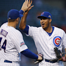 Chicago Cubs first baseman Anthony Rizzo, left, and relief pitcher Hector Rondon celebrate defeating the San Francisco Giants in acontinuationof arain-suspended baseballgame that beganTuesday, on Thursday, Aug. 21, 2014, in Chicago. The Chicago Cubs won 2-1. (AP Photo/Andrew A. Nelles)
