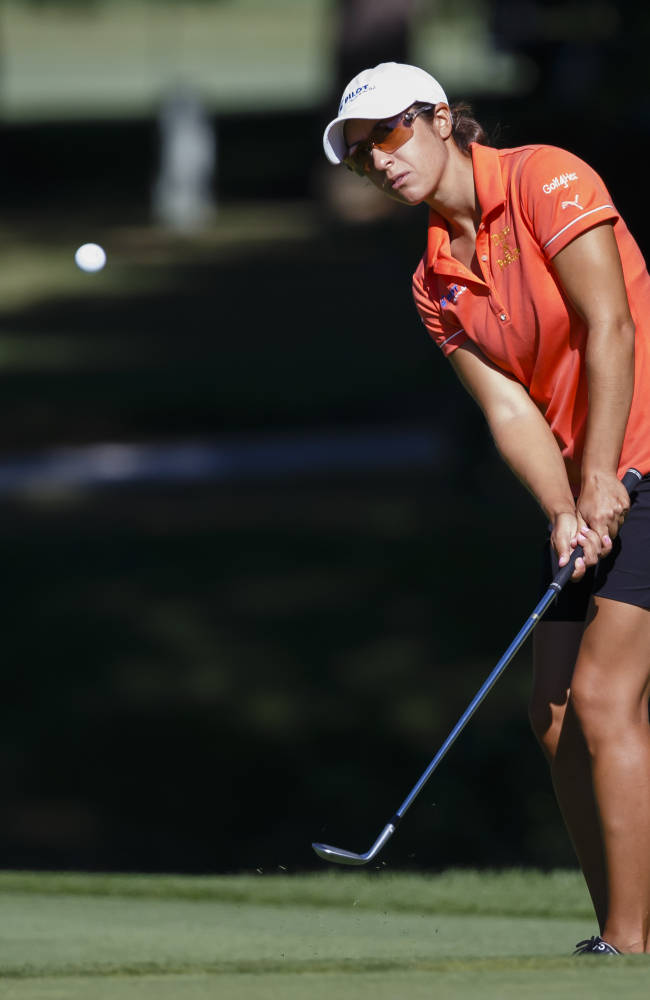 Marina Alex chips onto the sixth green during the the first round of the Marathon Classic LPGA golf tournament at Highland Meadows Golf Club in Sylvania, Ohio, Thursday, July 17, 2014