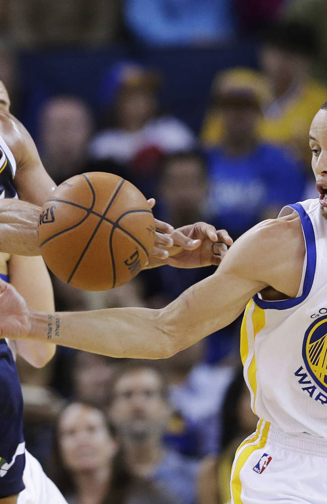 Golden State Warriors guard Stephen Curry (30) strips the ball from Utah Jazz forward Richard Jefferson, left, during the first half of an NBA basketball game Sunday, April 6, 2014, in Oakland, Calif
