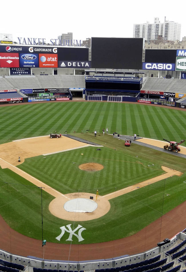 In this photo provided by the New York Yankees, a grounds crew converts the baseball diamond to a soccer field at Yankee Stadium in New York, Thursday, July 19, 2012. In the very first soccer match played at the new stadium, Chelsea FC plays Paris-Saint Germain on Sunday, July 22