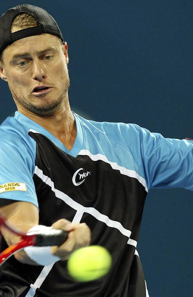 Lleyton Hewitt of Australia plays a shot in his 2nd round match against Thanasi Kokkinakis of Australia during the Brisbane International tennis tournament in Brisbane, Australia, Tuesday, Dec. 31, 2013