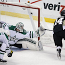 Pittsburgh Penguins' Chris Kunitz (14) gets a shot past Dallas Stars goalie Kari Lehtonen (32) for a goal during the first period of an NHL hockey game in Pittsburgh, Thursday, Oct. 16, 2014 The Associated Press