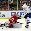 Toronto Maple Leafs defenseman Jake Gardiner (51) scores on Detroit Red Wings goalie Jimmy Howard (35) in the third period of an NHL hockey game in Detroit, Tuesday, March 18, 2014 The Associated Press