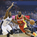 Houston Rockets' James Harden (13) drives around Orlando Magic's Maurice Harkless (21) during the first half of an NBA basketball game in Orlando, Fla., Wednesday, March 5, 2014 The Associated Press