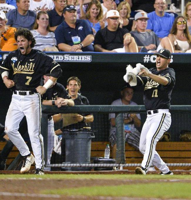 Vanderbilt payers Ro Coleman (1), Dansby Swanson (7), Tyler Beede (11) and Brian Miller, right, cheer on teammate Zander Wiel, unseen, after he scored in the fifth inning on a hit by Rhett Wiseman in the fifth inning of an NCAA baseball College World Series game against Texas in Omaha, Neb., Saturday, June 21, 2014