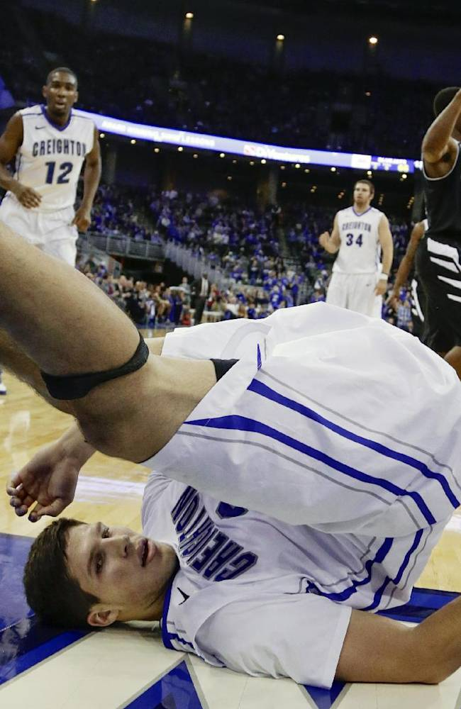 Creighton forward Doug McDermott (3) lands on his back after being fouled in the second half of an NCAA college basketball game against Missouri-Kansas City, in Omaha, Neb., Monday, Nov. 11, 2013