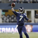Seattle Seahawks quarterback Tarvaris Jackson throws against the Chicago Bears in the second half of a preseason NFL football game, Friday, Aug. 22, 2014, in Seattle The Associated Press