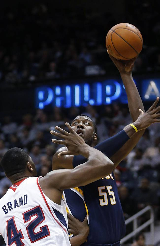 Indiana Pacers center Roy Hibbert (55) takes a shot against Atlanta Hawks power forward Elton Brand (42) in the first  half of an NBA basketball game, Tuesday, Feb. 4, 2014, in Atlanta