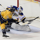 Nashville Predators center Colin Wilson (33) scores a goal against St. Louis Blues goalie Martin Brodeur (30) in the third period of an NHL hockey game Thursday, Dec. 4, 2014, in Nashville, Tenn. The Predators won 4-3 The Associated Press