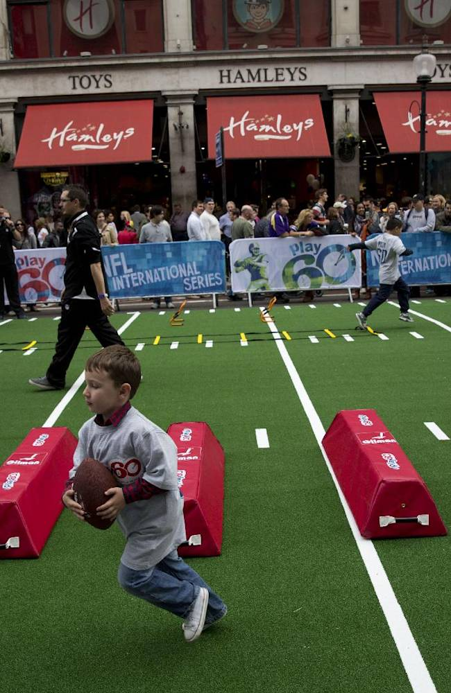 Children take part in NFL activities outside the Hamleys toy store, a popular tourist destination, during an NFL fan rally event in Regent Street, central London, Saturday, Sept. 28, 2013.  The Minnesota Vikings are to play the Pittsburgh Steelers at Wembley stadium in London on Sunday, Sept. 29 in a regular season NFL game