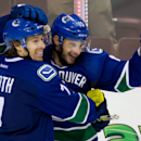 Vancouver Canucks' David Booth, left, and Brad Richardson celebrate Richardson's goal against the Los Angeles Kings during the third period of an NHL hockey game Saturday, April 5, 2014, in Vancouver, British Columbia. Vancouver won 2-1 The Associated Pre