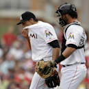 Miami Marlins starting pitcher Nate Eovaldi, left, walks back to the mound while talking with catcher Jarrod Saltalamacchia during the first inning of an exhibition spring training baseball game against the Boston Red Sox Thursday, March 6, 2014, in Jupit